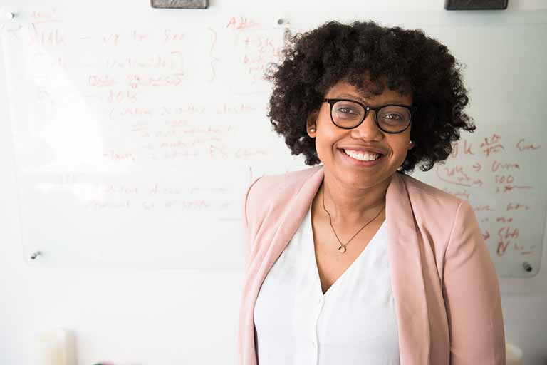 african american teacher in front of whiteboard