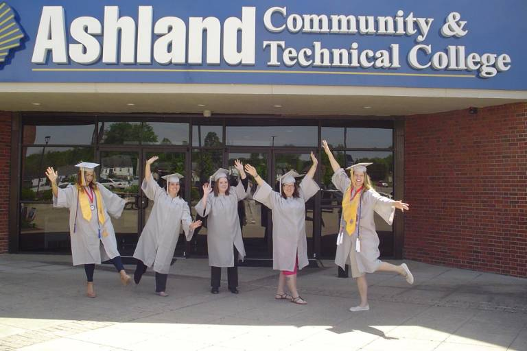 ACTC Grads in front of building